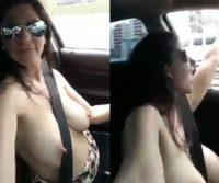Mulher dirige com peitos de fora fazendo topless e viraliza na web; veja